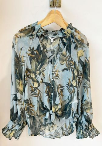 Blouse with an all over tropical print